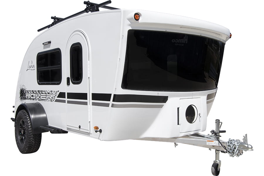 Best teardrop campers - the exterior of the Luna Rover showing a black roof rack and a large panoramic windshield.